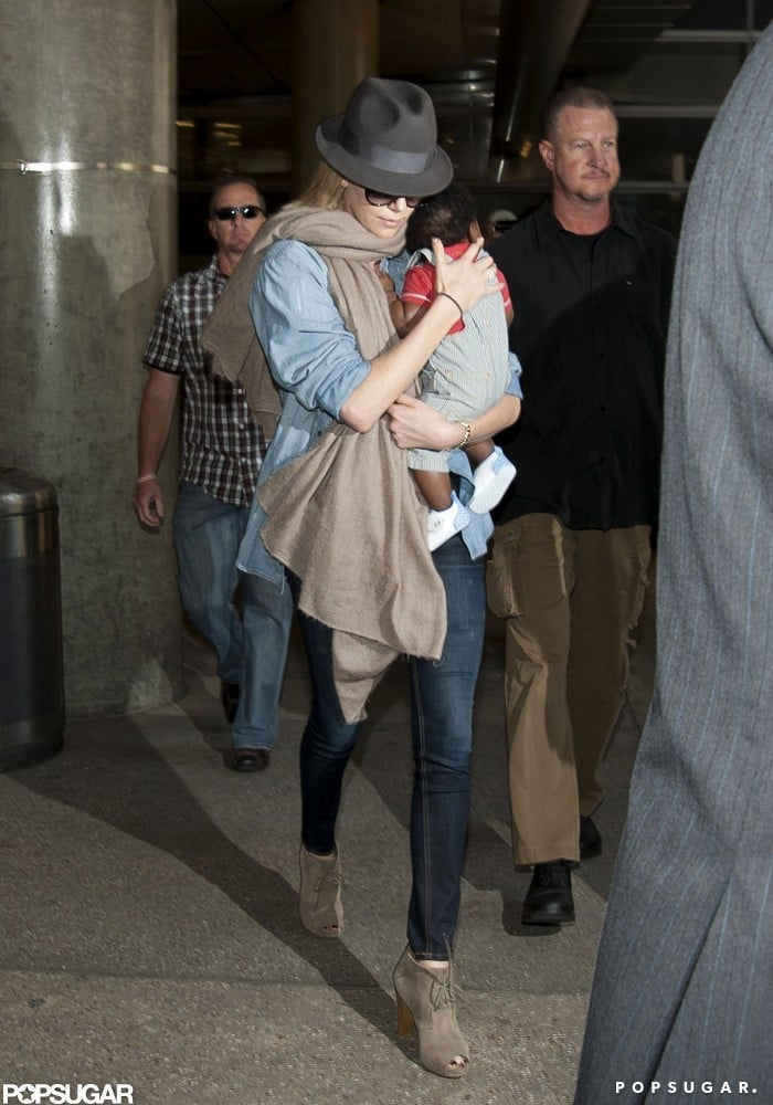 Charlize Theron held on tight to Jackson while leaving LAX.