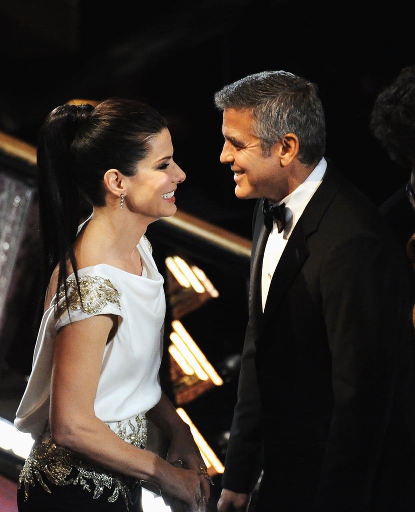 Here's Proof That Clooney Only Gets Better With Age - Page 2 George-Clooney-met-up-Sandra-Bullock-February-2012-Oscars