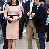 On Oct. 16, Kate attended the Charities Forum Event at Paddington Station with Prince William and Prince Harry. She wore a pink three-quarter sleeve dress from Orla Kiely that featured a playful 3-D floral design. She stayed up on her toes with a pair of black block heels that matched the trimmings on her dress.