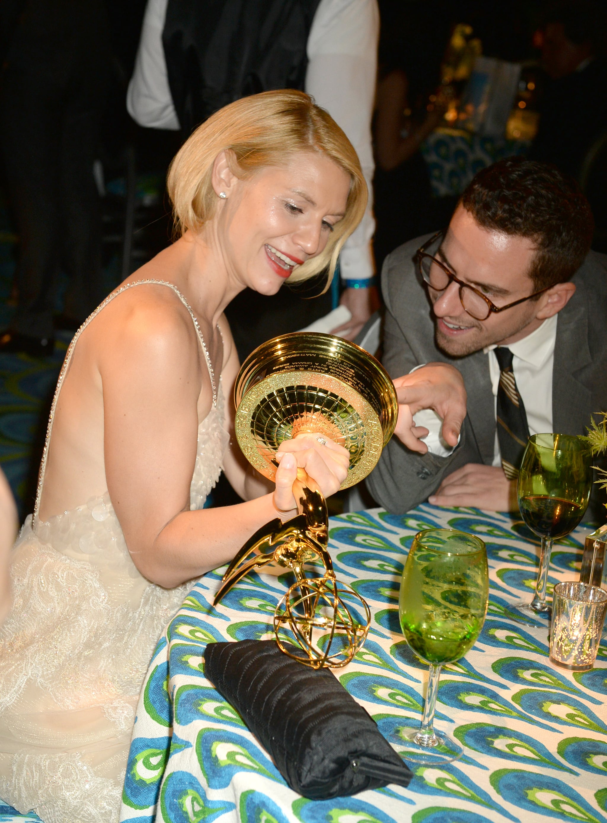 Clarie Danes looked at her award at the 2013 HBO Emmys afterparty.