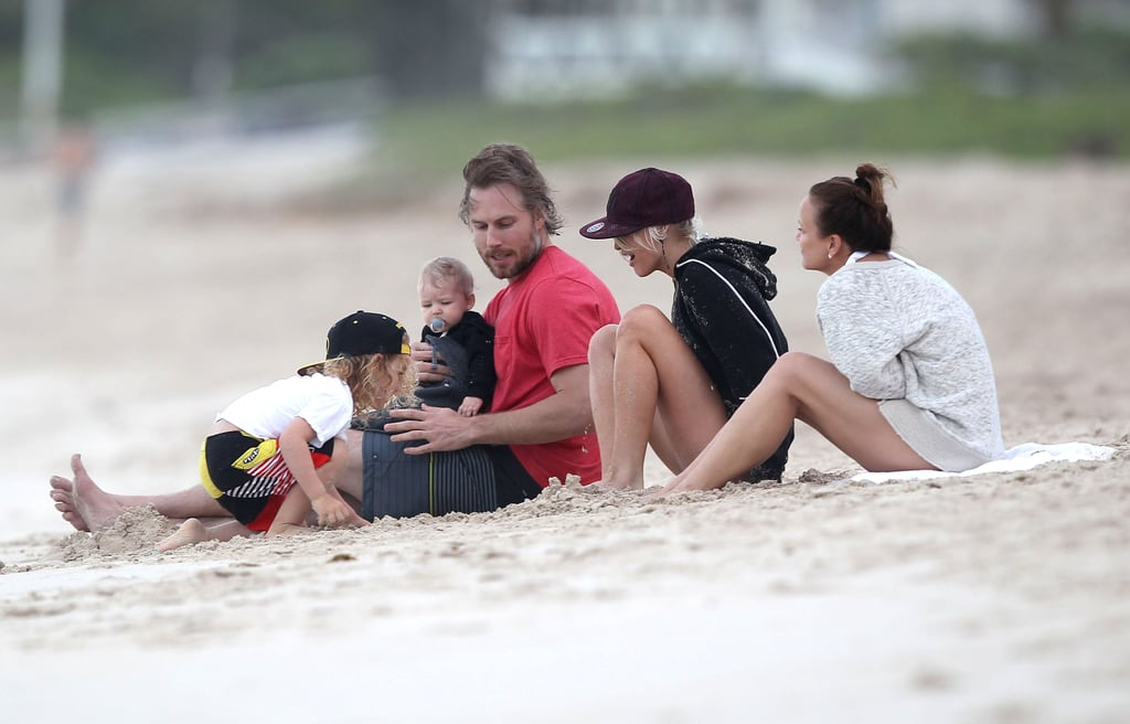 Ashlee Simpson, Bronx Wentz, and Tina Simpson sat on the beach with Eric Johnson and Maxwell Johnson.
