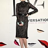 Coco Rocha suited up in a textured body-con sheath.