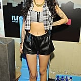 Cher Lloyd followed suit in leather shorts, a heather grey crop top, and a flannel vest.