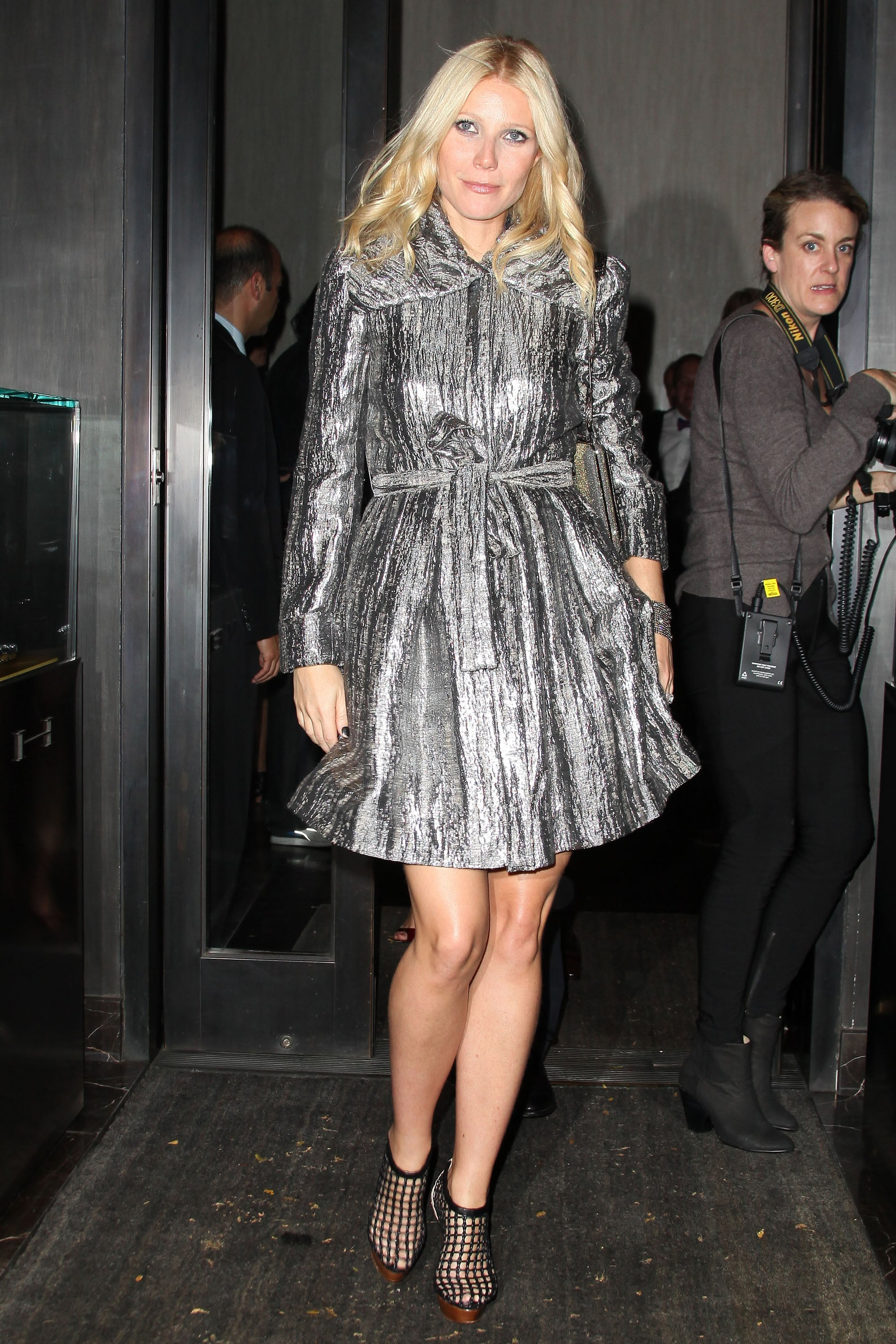 e9bcf390131 Gwyneth shined in a dazzling metallic trench and caged Christian ...