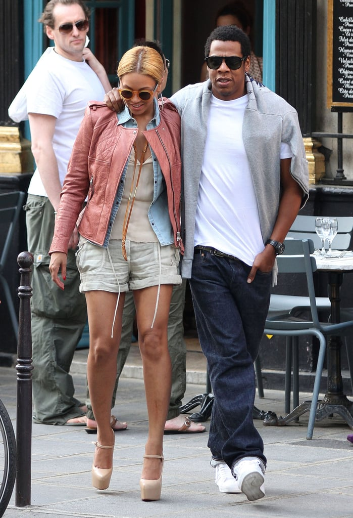 In April 2011, Beyoncé layered up in a chambray blouse and a pink leather Isabel Marant jacket while Jay Z threw a gray sweater over his crisp white tee for a stroll in Paris.