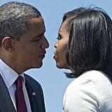 The Obamas went in for a kiss.