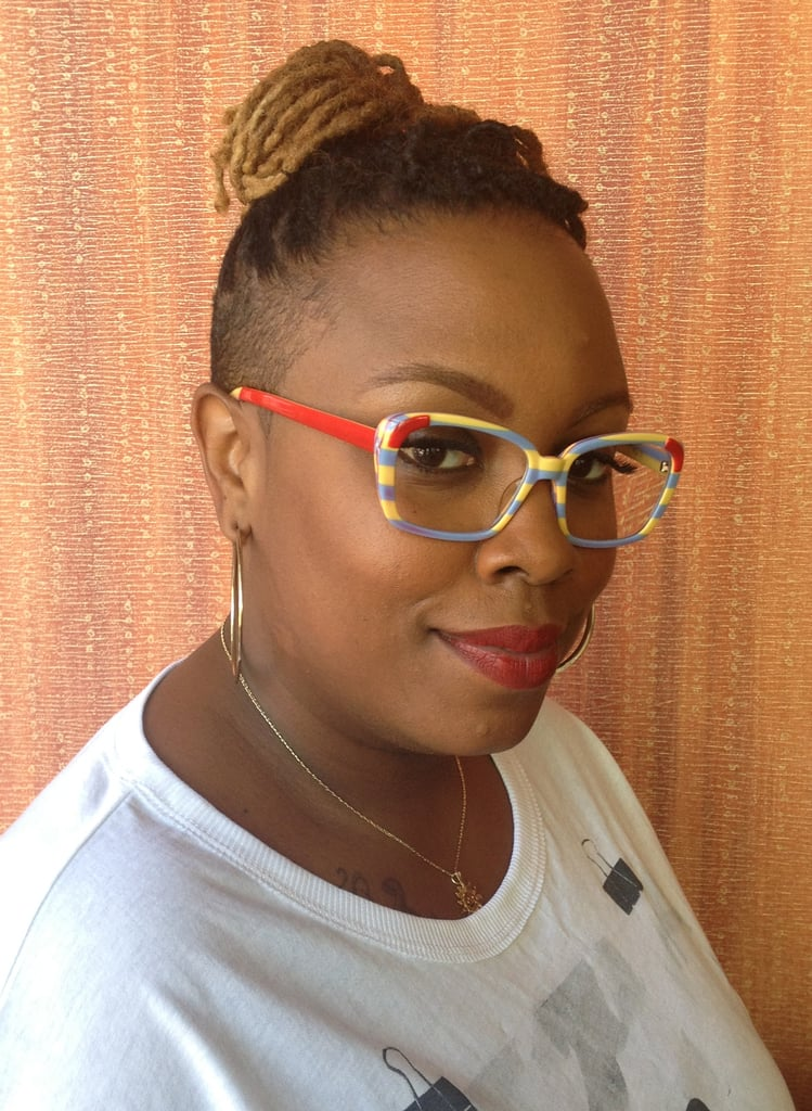Stacy's style has a playfulness with her undercut hairstyle, bright crimson lip, and funky glasses.