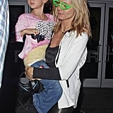 Heidi wore green glasses to the concert.