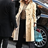 She wore a leopard print top with wide-leg black trousers and a trench coat in November 2016.