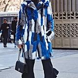 On Editor Sarah Wasilak: Karen Millen coat, Zara pants, Dior bag, and Steve Madden boots