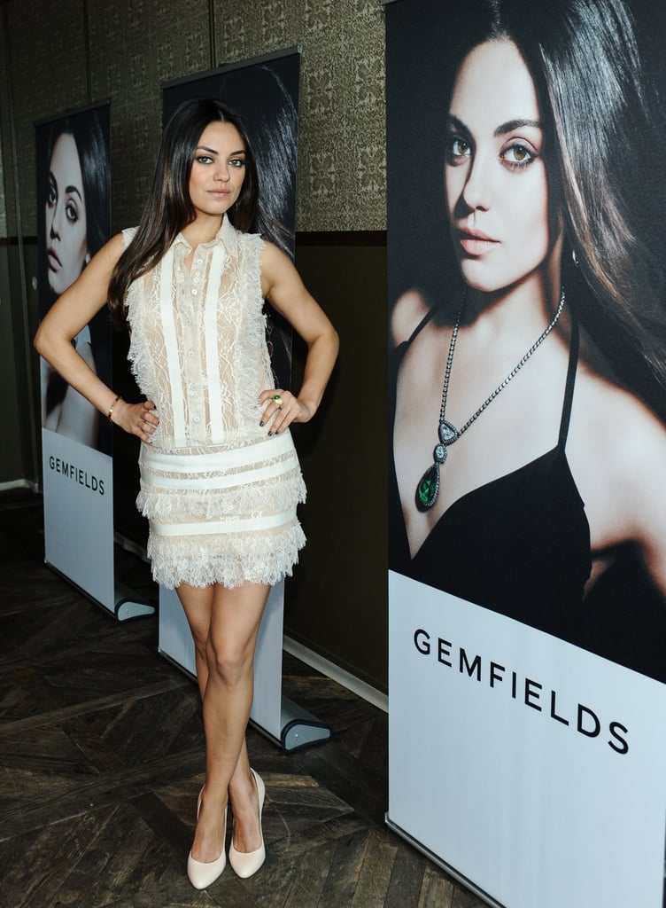 Mila Kunis posed alongside her own portrait for Gemfields in an ultrafemme white lace Elie Saab ensemble.