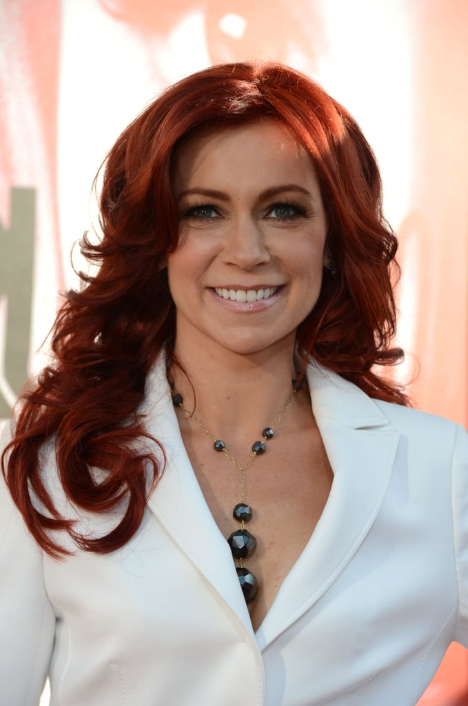 Carrie Preston paired her white suit with a dangling necklace.