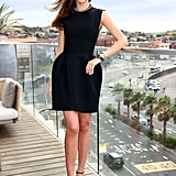 Miranda amped up her classic LBD with an embellished-collar and statement sandals at Bondi Beach in Sydney.