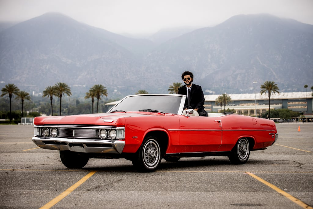 """The Weeknd's performance at Sunday's Billboard Music Awards was everything we wanted and more. After ditching his signature red suit for a black coat and trousers, the 31-year-old singer put on quite a show as he performed """"Save Your Tears"""" in a parking lot packed with red and white cars. The whole thing looked like a scene straight out of a movie. In addition to his performance, The Weeknd took home the most awards of the night with a total of 10, including top artist, top R&B album, and top male artist. On top of that, The Weeknd is only the second artist in Billboard history to have three No. 1 singles on the Hot 100 chart in three different years from one album. In The Weeknd's case, it was his After Hours album. Clearly, the lights aren't dimming anytime soon for him. Check out his performance ahead.      Related:                                                                                                           See Every Stylish Red Carpet Look From the 2021 Billboard Music Awards"""