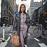 On Editor Sarah Wasilak: Rebecca Taylor coat and jumpsuit, Dolce Vita boots, and Balenciaga bag.