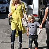 A great way to wear a Summer dress in the Fall, Gwen ran errands with her son in a yellow tunic and jeans.