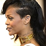 We love Rihanna's half ladylike, half cool-girl shaved hairdo — check out those tattoos!