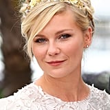 At the 2012 Cannes Film Festival, Kirsten's floral headband atop a curled updo made for a whimsical look.