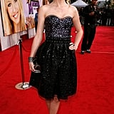Channeling her inner black swan in a raven-hued jeweled creation for the Hannah Montana: The Movie premiere in 2009.