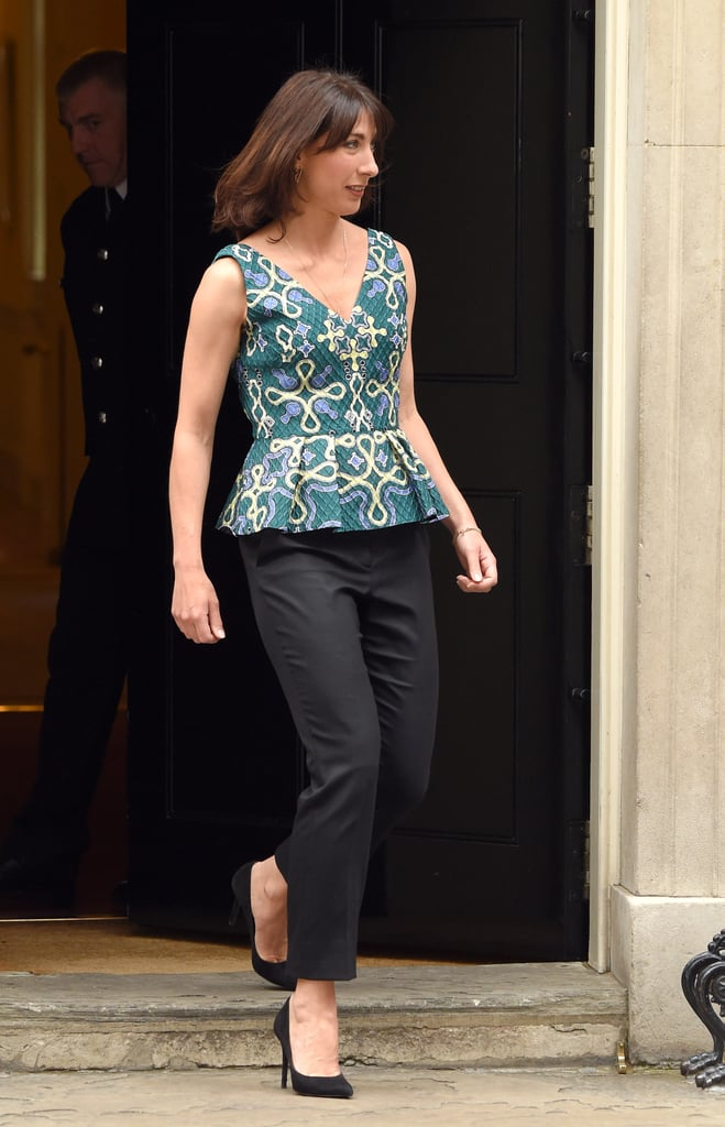 A Peplum Top and Black Trousers Is Always a Lady-Like Look