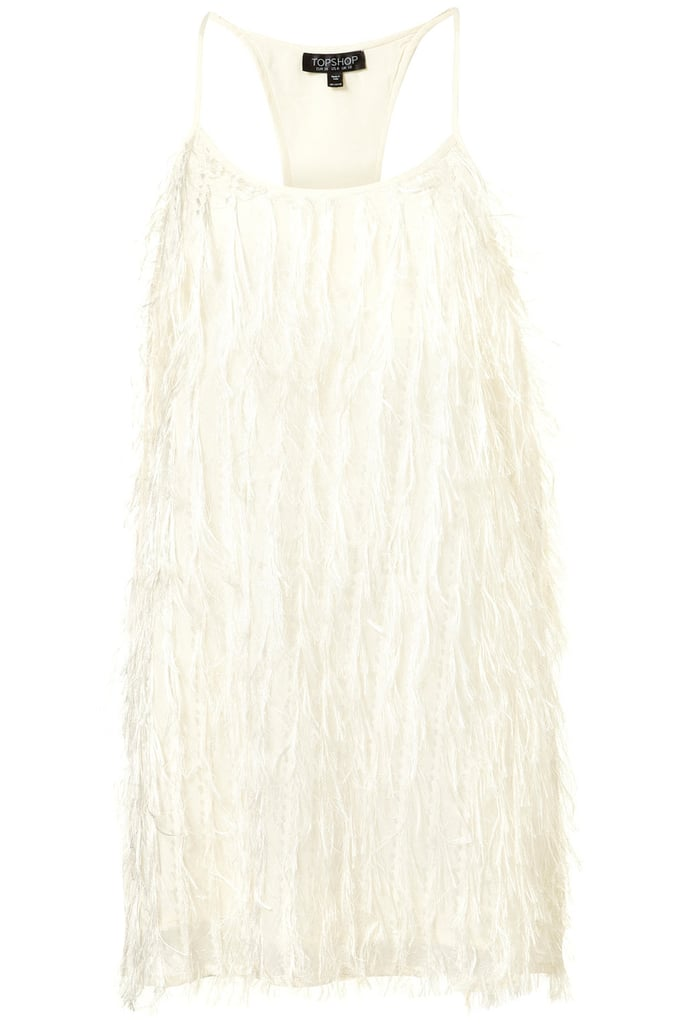 Try a lightened-up version of Kate Bosworth's Met Gala look in this bright white fringed tank dress.  Topshop Fringe Racer Back Dress ($120)