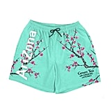 The Teal Swimming Shorts Prominently Feature Those Pretty Pink Flowers