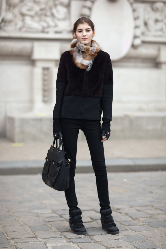 All black becomes so much more with a luxe fur collar and studded sneakers. Source: Le 21ème | Adam Katz Sinding