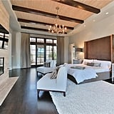 Wooden beams add texture and style to the bedroom ceiling.