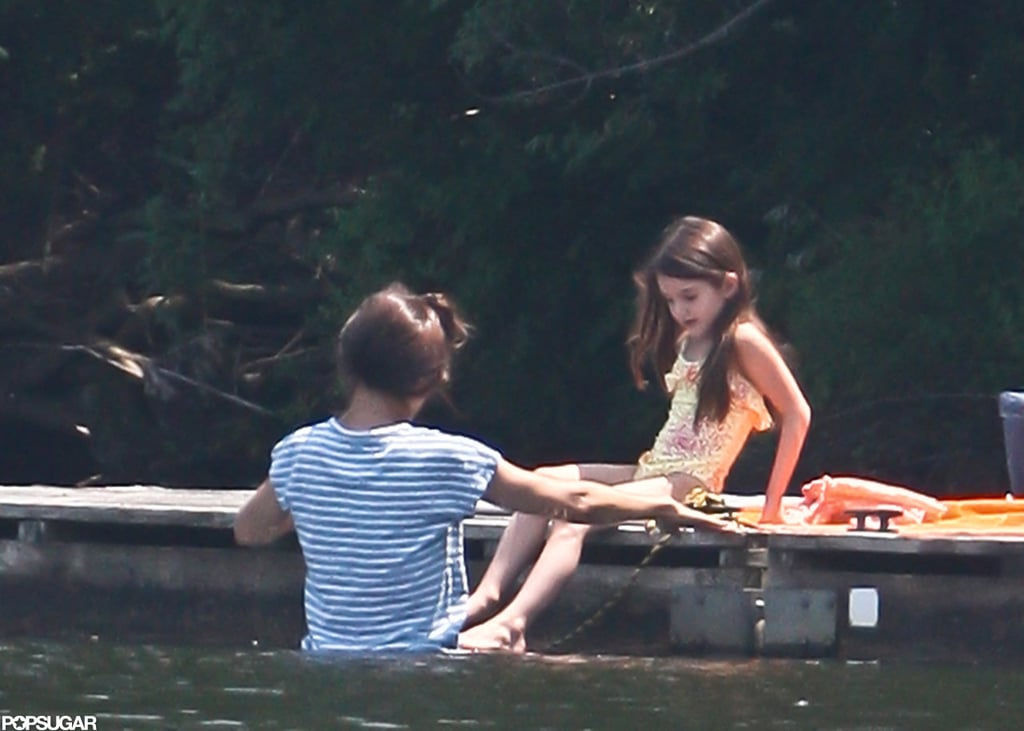 Katie Holmes helped Suri Cruise into the pond.