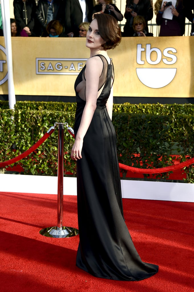 Michelle Dockery looked stunning when she wore a black vintage Chado Ralph Rucci gown to the SAG Awards in LA today. The Downton Abbey actress is up for one of the night's big awards, outstanding performance by a female actor in a drama series, where she will face off against Claire Danes, Jessica Lange, Julianna Margulies and her co-star, Maggie Smith, to earn the honour. Michelle and her Downton Abbey co-stars are also nominated for outstanding performance by an ensemble in a drama series. This mark's Michelle's first SAG Awards ceremony and her first time ever being nominated by the Screen Actors Guild.