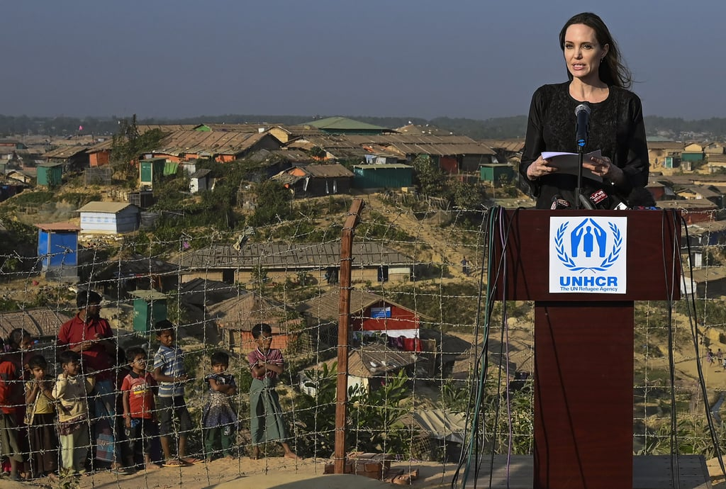 "Angelina Jolie is continuing her mission to make a difference in the world. The 43-year-old actress and Special Envoy for the United Nations High Commissioner For Refugees (UNHCR) touched down in Bangladesh on Monday for her official three-day visit in Cox's Bazar. The country has been home to more than 730,000 Rohingya refugees from Myanmar since August 2017, and Angelina is on hand to help those in need and assess the challenges Bangladesh is currently facing as a host country. On Tuesday, Angelina visited a school at Kutupalong refugee camp and hosted a press conference ahead of a new appeal for nearly $1 billion to look after the refugee influx.  In her speech, Angelina touched on ""Bangladesh's generosity in giving Rohingya people a place of safety"" and urged Myanmar authorities to ""show the genuine commitment needed to end the cycle of violence and displacement."" ""I am here to see what more can be done to ensure Rohingya children can gain education with recognized qualifications that they need to retain a clear vision for their futures, and, when conditions allow, rebuild their communities in Myanmar,"" Angelina added. ""To the Rohingya refugees, I want to say I am humbled and proud to stand with you today. You have every right to live in security, to be free to practice your religion and to coexist with people of other faiths and ethnicities. You have every right not to be stateless, and the way you have been treated shames us all."" Angelina is also set to visit Dhaka, where she'll have meetings with Prime Minister Sheikh Hasina and Foreign Minister AK Abdul Momen to discuss how the UNHCR can support the Bangladeshi government. This marks Angelina's first visit to the country and comes ahead of the launch of the 2019 Joint Response Plan, which aims to raise $920 million to help the Rohingya refugees.       Related:                                                                                                           6 Impactful Ways Angelina Jolie Is Making a Difference in the World"
