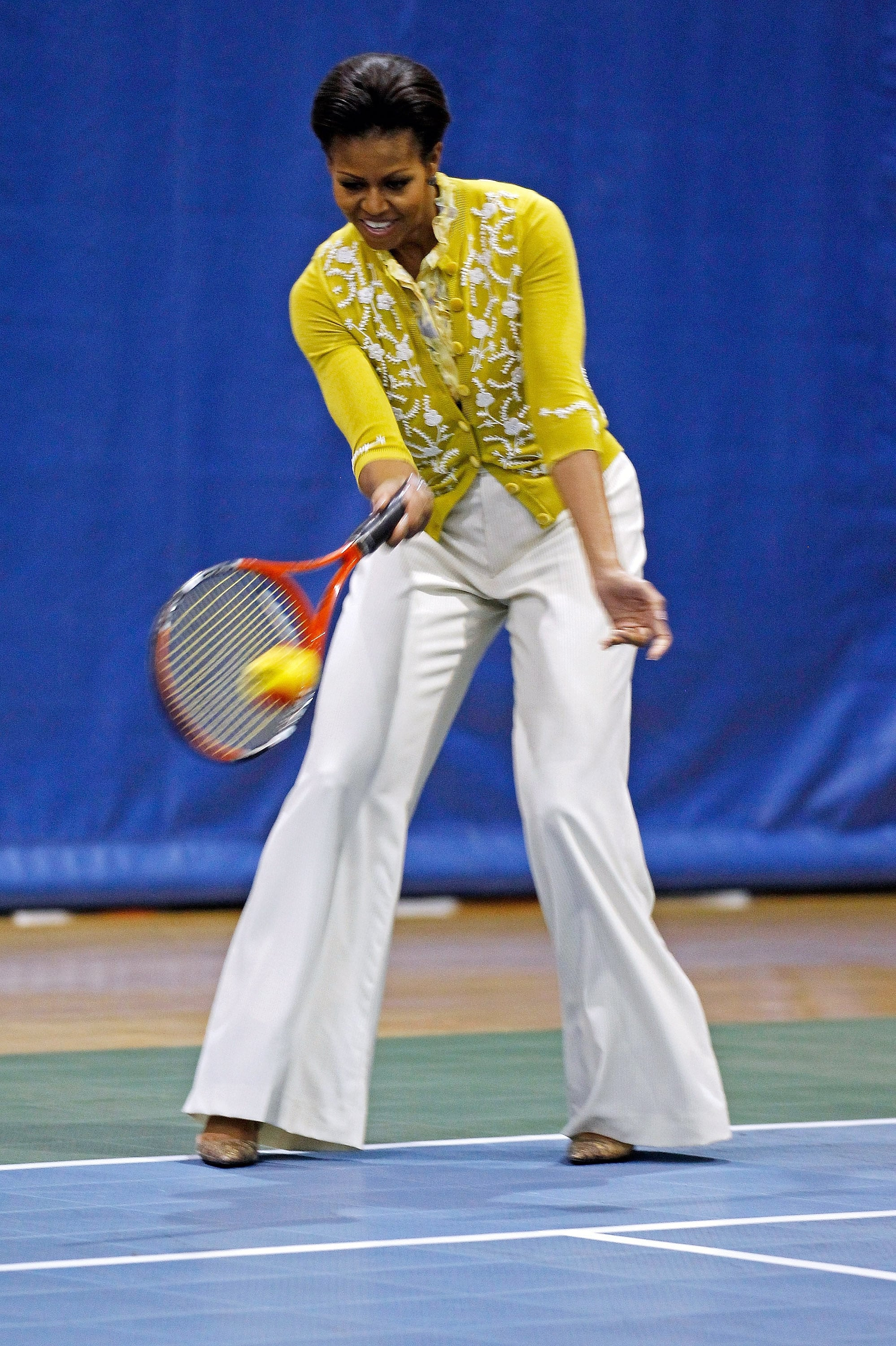 Match point! Michelle showed her sporty side by playing tennis with schoolchildren in wide-leg trousers by Zero + Maria Cornejo and a L'Wren Scott blouse and cardigan.