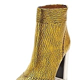 Add a daily golden pop to your look with these modern crackled Phillip Lim Peggy Metallic Ankle Booties ($725).