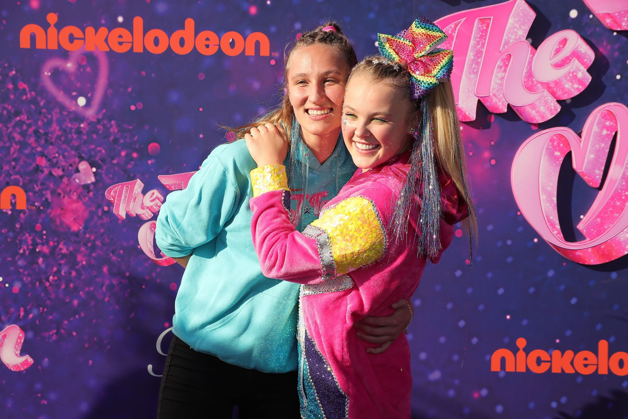 PASADENA, CALIFORNIA - SEPTEMBER 03: (L-R) Kylie Prew and JoJo Siwa attend a drive-in screening and performance for the Paramount+ original movie