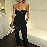 Angie Harmon kept it cool in a strapless, bow-adorned Azzaro jumpsuit.