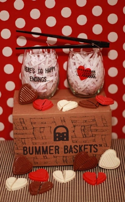 Give her reason to smile with a Breakup Bummer Basket ($20) that comes with broken heart chocolates, wine glasses, and more fun goodies.