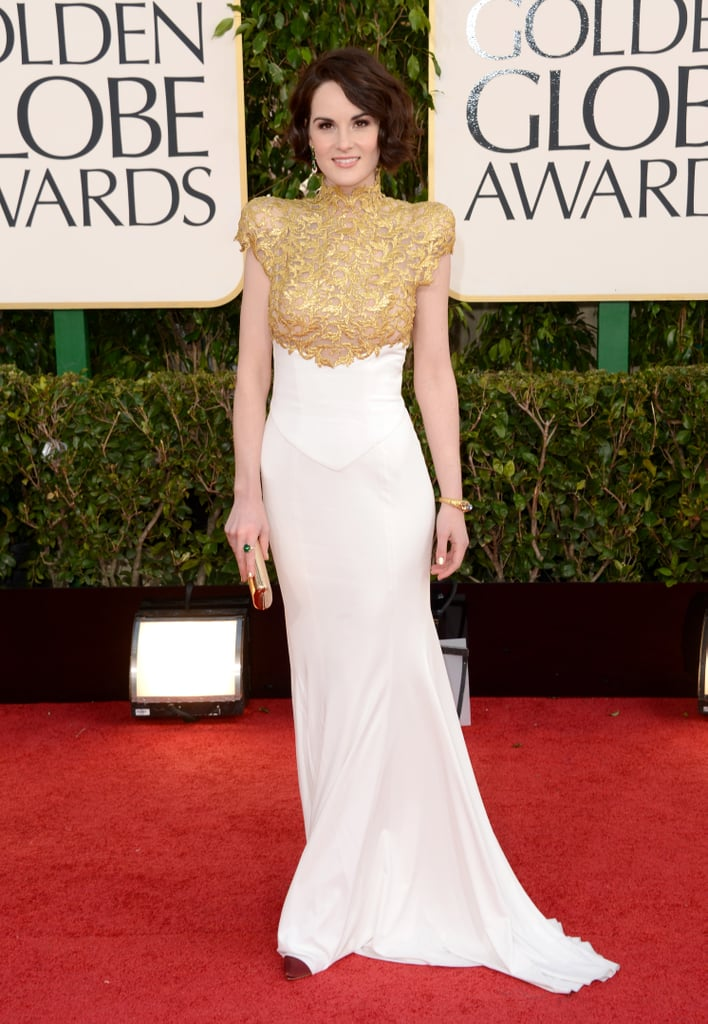 Downton Abbey's Michelle Dockery looked statuesque in this gorgeously gilded gown by French couturier Alexander Vaulthier.
