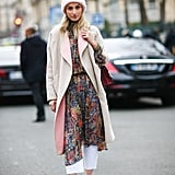 Instead of wearing your dress with blue denim, switch it up with a white pair. This street style star made it look effortless with her paisley-printed dress and plaid coat.