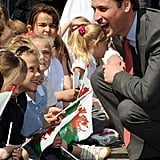 Will knelt down to chat with a group of little cuties during a May 2008 visit to the Valley Kids Project in England.