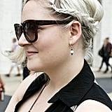 Platinum blond hair got amplified with an asymmetrical braided updo. Photo by Caroline Voagen Nelson
