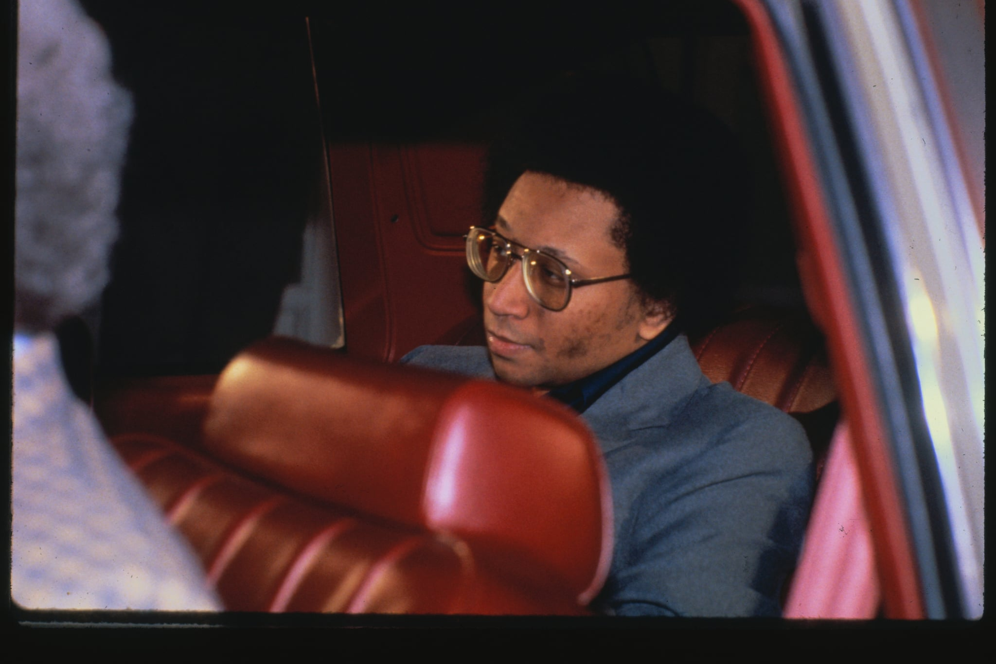 Accused in Atlanta child murders, Wayne Williams sits in back of car on his way to his court trial in 1982.