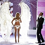 Heidi blows a kiss to Seal while he performs at the Victoria's Secret Fashion Show in 2005.