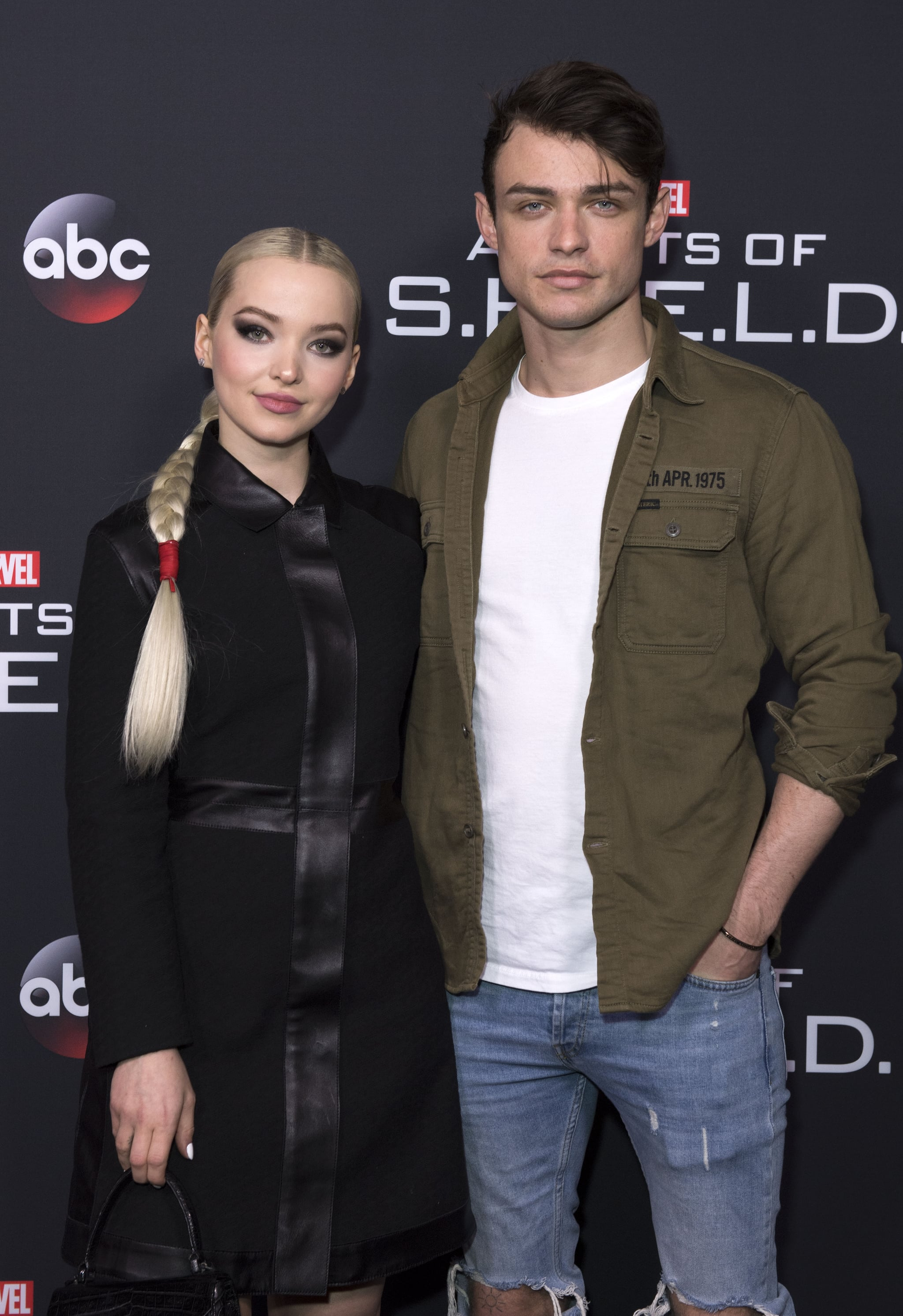 Actors Dove Cameron (L) and Thomas Doherty attend Marvels Agents of S.H.I.E.L.D. 100th Episode Celebration in Hollywood, California, on February 24, 2018.  / AFP PHOTO / VALERIE MACON        (Photo credit should read VALERIE MACON/AFP/Getty Images)