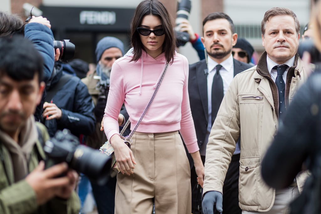 Kendall wore her cropped Vetements x Champion hoodie with a pair of high-waisted khaki trousers and a Fendi purse.