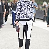 Caroline Issa pepped up her black and white trousers with print.