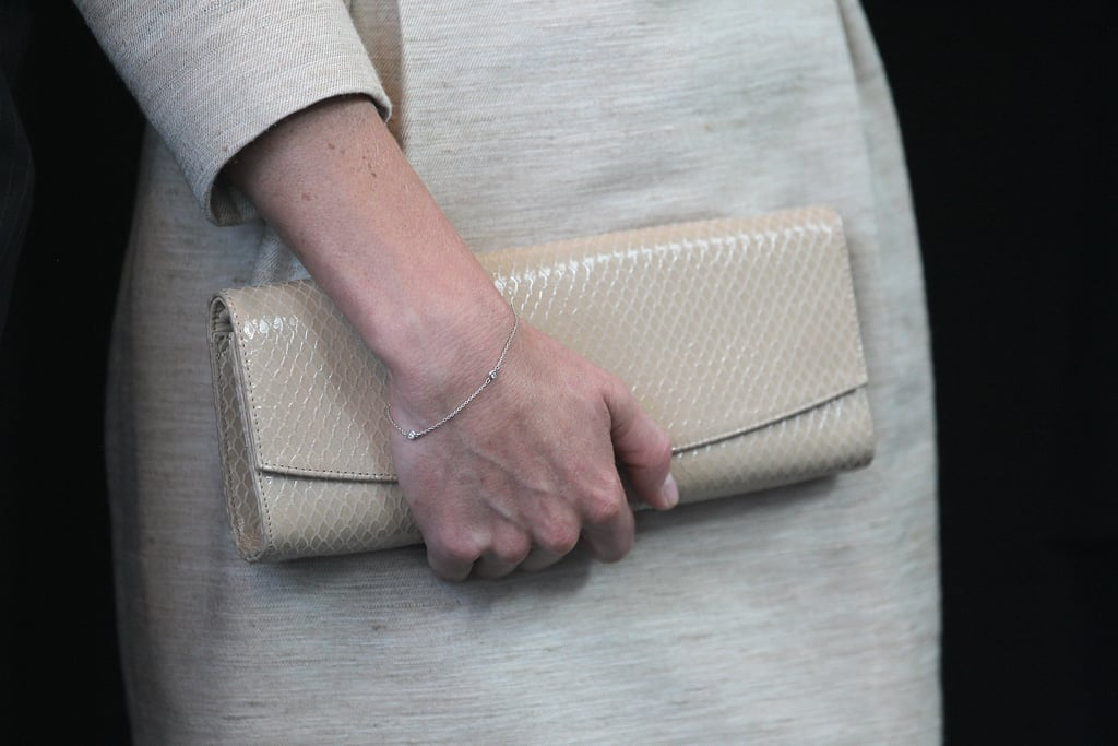 She paired her By Malene Birger linen dress with a snakeskin-textured long clutch.