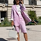 Go for a ladylike look with your shorts by opting for a tailored suit in a pale pink hue.