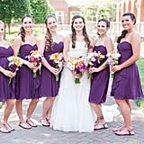 This bride went with short purple dresses for her bridesmaids.