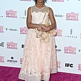 Quvenzhané Wallis chose a sweet pale-pink, sheer-necklined Stella McCartney dress to go with yet another one of her adorable stuffed-animal dog purses.