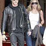 Jennifer Aniston and Justin Theroux left their Paris hotel in shades during their June getaway.
